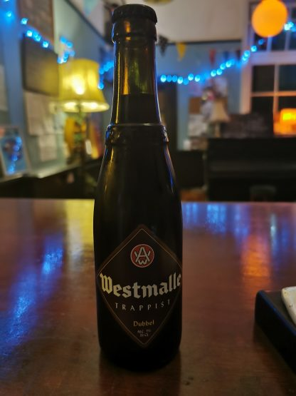 Brown Bottle with brown diamond label on a polish wooden surface